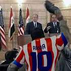 Arda Turan throw's boot at former president George Bush!