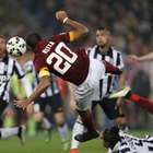 10-man Roma salvages a draw with Juventus